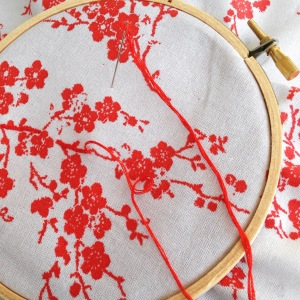 First project: embroidering cherry blossoms, learning the stem stich and the lazy daisy stitch.